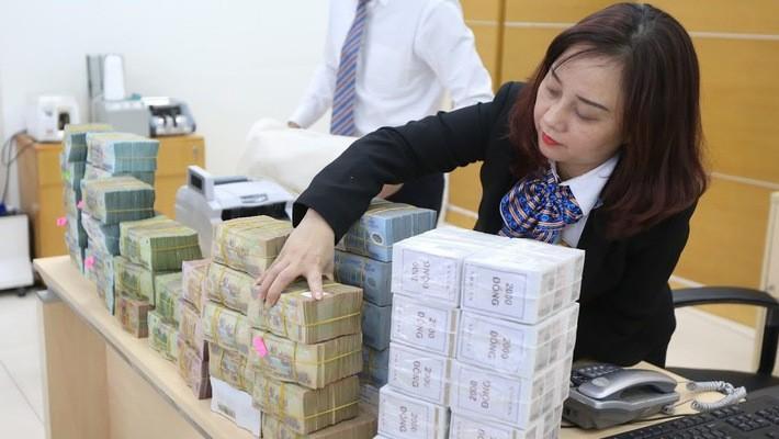 2018 đang bắt đầu gợi mở những con số lợi nhuận rất lớn của hệ thống ngân hàng Việt Nam, những quy mô chưa từng đạt được trong lịch sử - Ảnh: Quang Phúc.