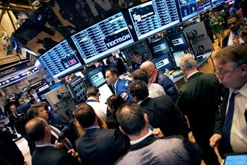 Trader trên sàn chứng khoán New York (NYSE). Ảnh:AFP