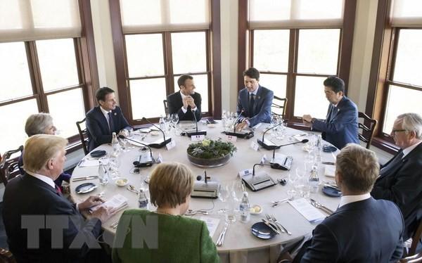 Lãnh đạo các nước G7 và EU nhóm họp bàn tròn tại Charlevoix, Quebec ngày 8/6. (Nguồn: EPA/TTXVN)