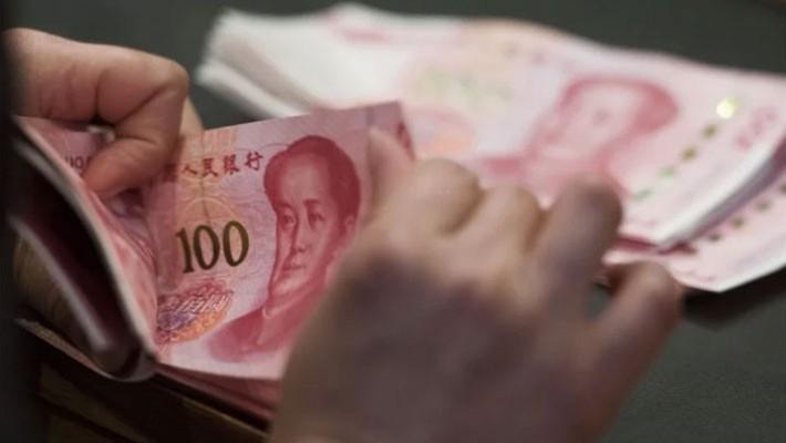 Sáng thứ Hai, tỷ giá Nhân dân tệ tại thị trường Hồng Kông tăng mạnh nhất 2 tháng - Ảnh: Bloomberg/SCMP.