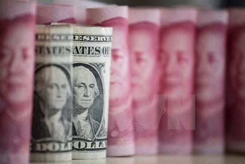 Đồng nhân dân tệ giảm giá so với đồng USD. Ảnh: AFP/TTXVN