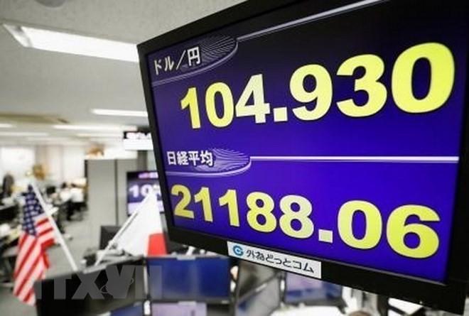 Bảng tỷ giá chứng khoán tại thủ đô Tokyo, Nhật Bản. (Nguồn: Kyodo/TTXVN)