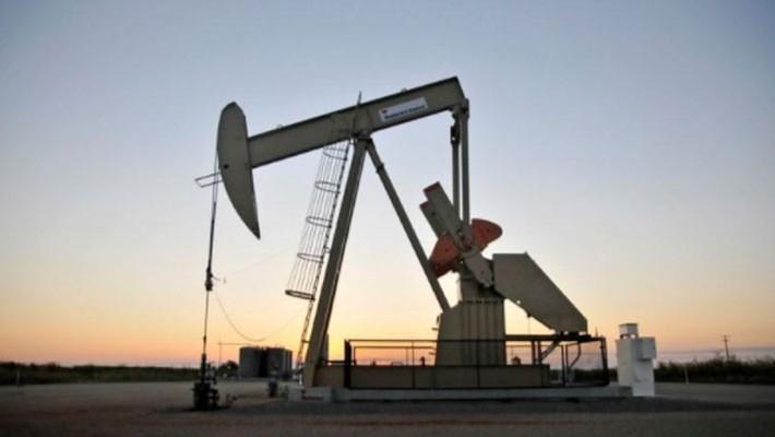 Một giếng dầu ở bang Oklahoma, Mỹ, hồi năm 2015 - Ảnh: Reuters.