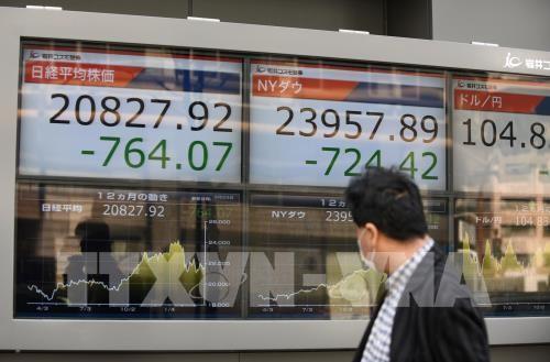 Chứng khoán châu Á phần lớn tăng điểm. AFP/TTXVN