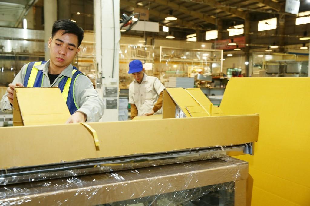 Cần tiếp tục cải thiện thực chất môi trường kinh doanh, tạo thuận lợi cho DN yên tâm đầu tư, mở rộng sản xuất. Ảnh: Tiên Giang