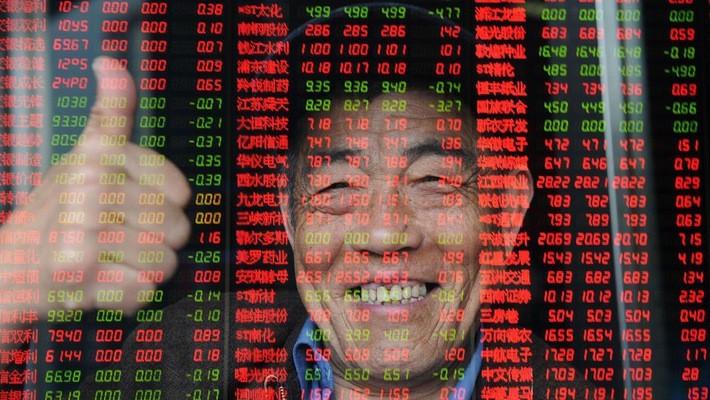 """Tin """"đình chiến"""" thương mại Mỹ-Trung giúp chứng khoán Trung Quốc tăng điểm sáng đầu tuần - Ảnh: Bloomberg."""