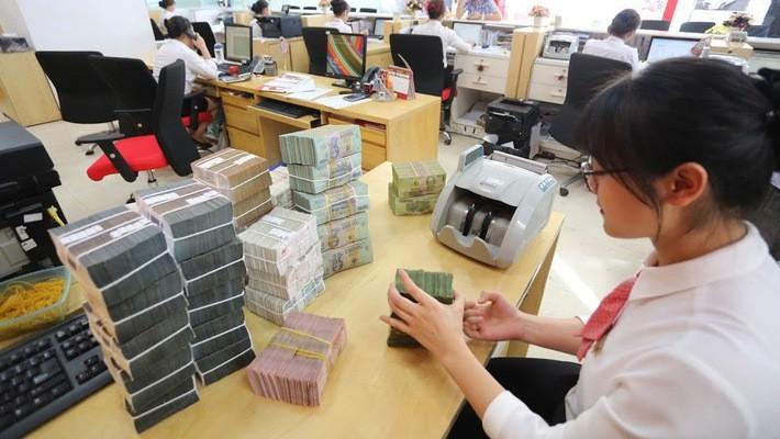 Cuối 2018, nhiều ngân hàng thương mại Việt Nam có thêm bước tiến mới về vốn điều lệ, chuẩn bị cho năm kinh doanh 2019 - Ảnh: Quang Phúc.
