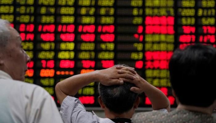 Nỗi lo suy giảm tăng trưởng kinh tế đang phủ bóng lên thị trường chứng khoán Trung Quốc - Ảnh: Reuters.