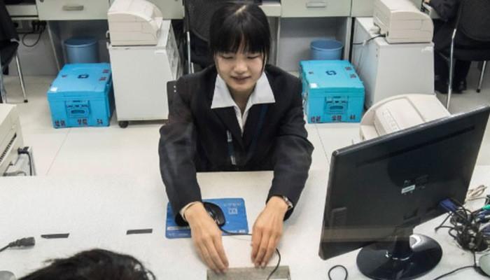 Ngành chứng khoán Trung Quốc đang trong giai đoạn khó khăn - Ảnh: Bloomberg.