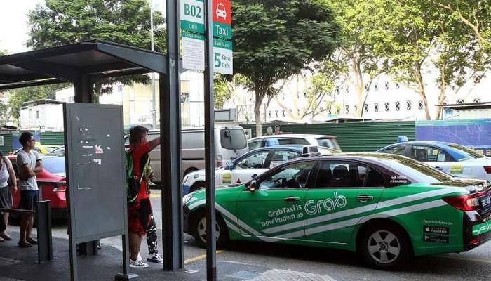 Dịch vụ taxi công nghệ đang rất phổ biến ở Singapore - Ảnh: Straits Times.