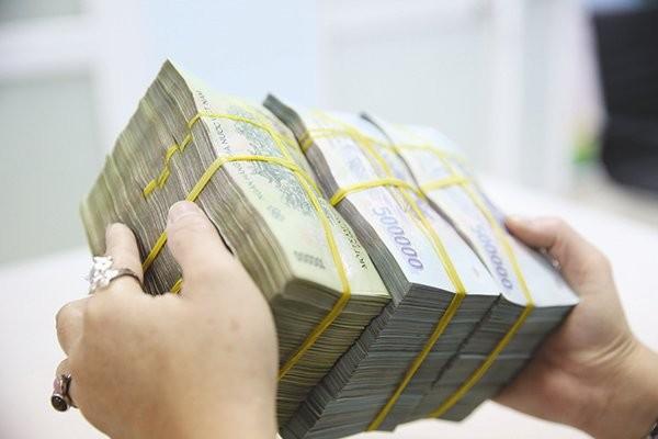 Nhu cầu về vốn cho đầu tư và tiêu dùng của toàn bộ nền kinh tế Việt Nam là rất lớn. Ảnh: THÀNH HOA