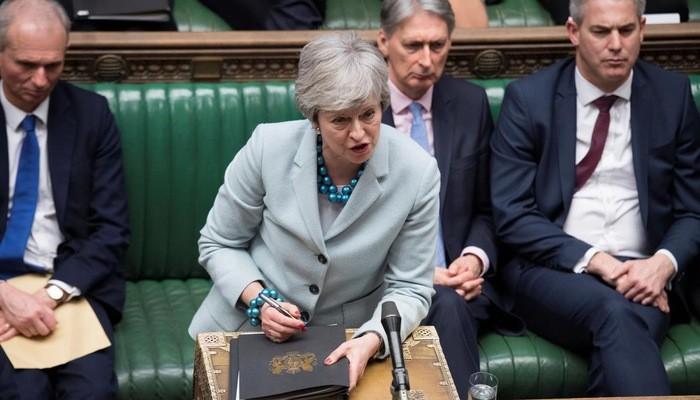 Thủ tướng Anh Theresa May tại Quốc hội hôm 25/3 - Ảnh: Reuters.