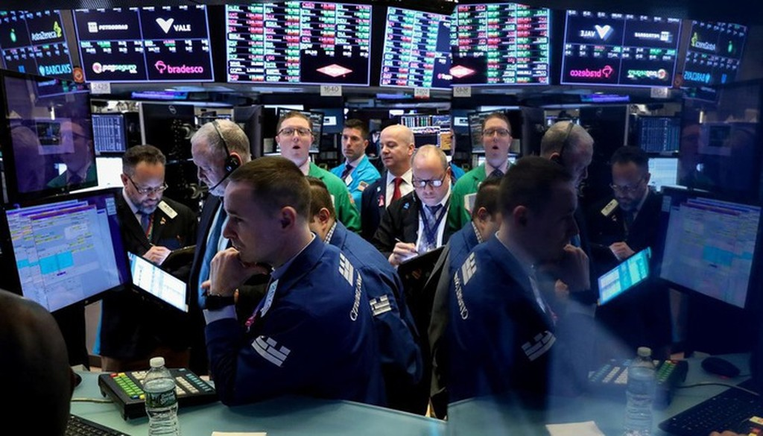 Các nhà giao dịch trên sàn chứng khoán New York - Ảnh: Reuters.