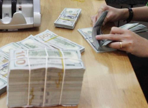 Sáng nay giá USD tiếp tục tăng nhẹ và giá đồng Nhân dân tệ (CNY) tương đối ổn định. . Ảnh: Trần Việt/TTXVN.