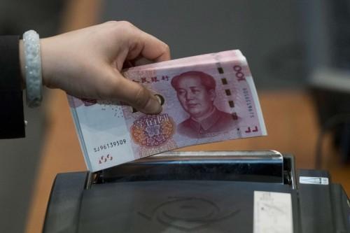 NDT có thể chạm ngưỡng tâm lý 7 NDT đổi 1 USD nếu không có tiến triển mới trên bàn đàm phán Mỹ - Trung. Ảnh:Bloomberg