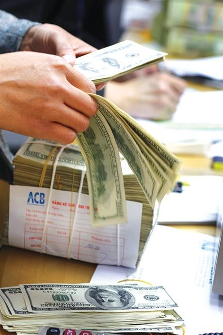 Tăng tỷ giá VND/USD lên 1%  và nới biên độ lên +/-3%