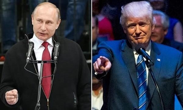 Tổng thống Mỹ Donald Trump (phải) và người đồng cấp Nga Vladimir Putin. Ảnh:Telegraph