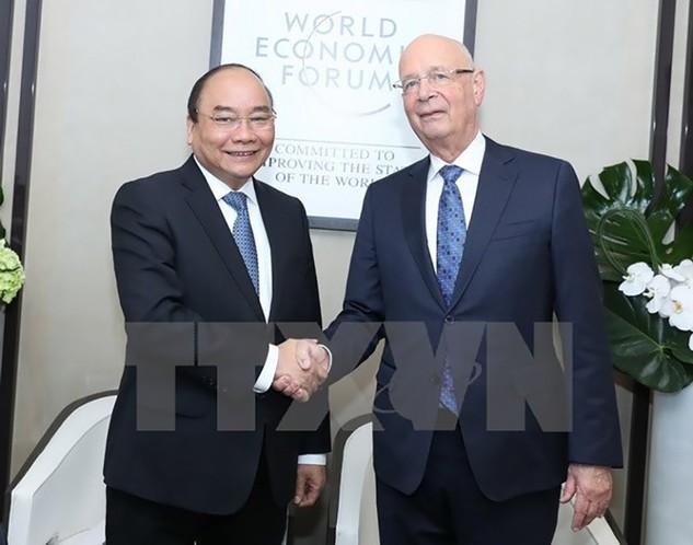 Thủ tướng Nguyễn Xuân Phúc gặp Chủ tịch Diễn đàn Kinh tế Thế giới (WEF) Klaus Schwab. (Ảnh: Thống Nhất/TTXVN)