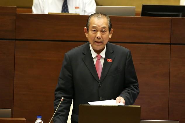 Phó Thủ tướng Thường trực Chính phủ Trương Hòa Bình trả lời chất vấn của các ĐBQH chiều 15/6. Ảnh: VGP