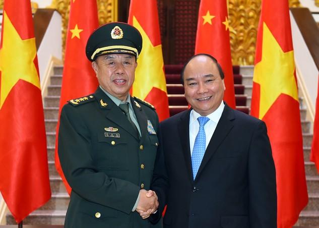 Thủ tướng Nguyễn Xuân Phúc và Thượng tướng Phạm Trường Long, Ủy viên Bộ Chính trị, Phó Chủ tịch Quân ủy Trung ương Trung Quốc. Ảnh: VGP