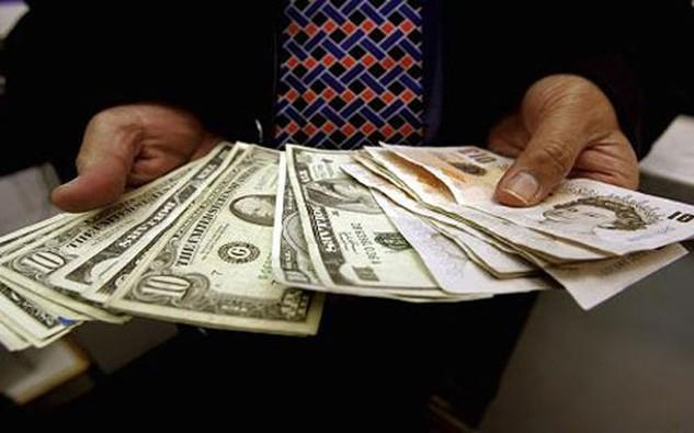 Một số ngân hàng gồm Citi và National Australia Bank dự báo tỷ giá đồng USD chỉ tăng khoảng 5% trong năm 2016, so với mức dự báo tăng 10% mà Deutsche Bank đưa ra - Ảnh: Getty/CNBC.