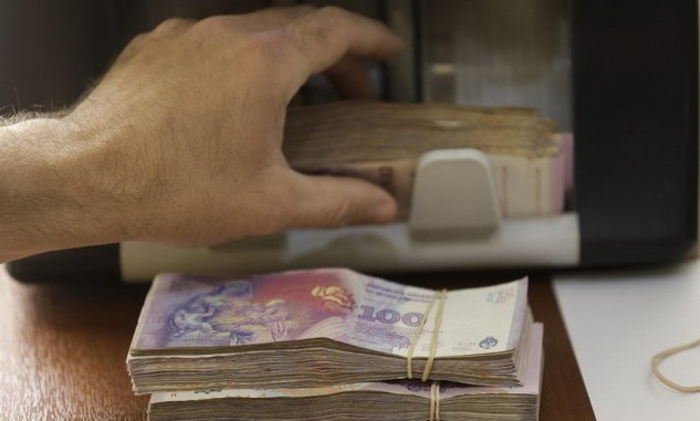 Đồng peso của Argentina được nhận định là sẽ tiếp tục giảm trong năm 2016 - Ảnh: news1130.com