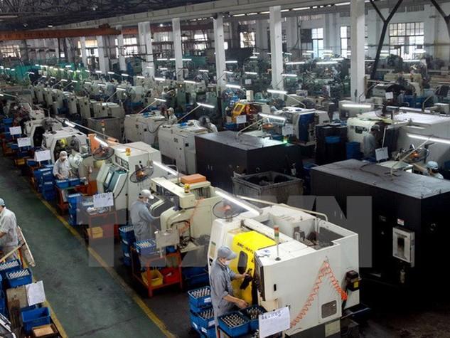 Sản xuất linh kiện xe máy tại Khu công nghiệp Sông Công, Thái Nguyên. (Nguồn: TTXVN)