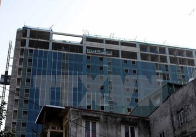 Tòa nhà 8B Lê Trực nhìn từ phố Sơn Tây. (Ảnh: Tuấn Anh/TTXVN)