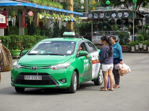 Mai Linh là một trong những hãng taxi đã giảm giá cước. Ảnh: Hoàng Hải - TTXVN
