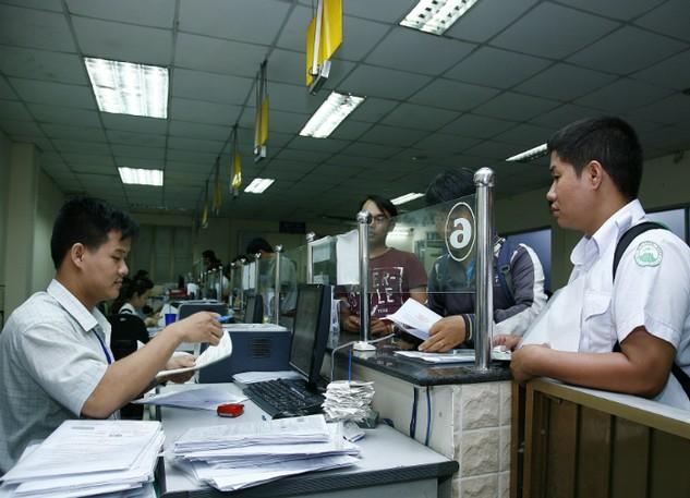Nhiều cơ quan yêu cầu DN phải có xác nhận ngành nghề đang kinh doanh trong khi luật đã bỏ. Ảnh: Tất Tiên