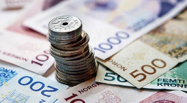 Tiền giấy và tiền xu Na Uy với các mệnh giá khác nhau - Ảnh: Reuters