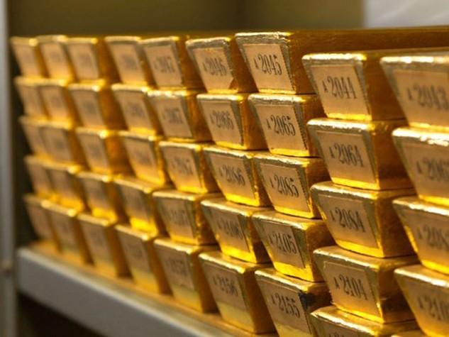 Mỗi ounce vàng phiên hôm qua giảm 0,6%. Ảnh: AFP.