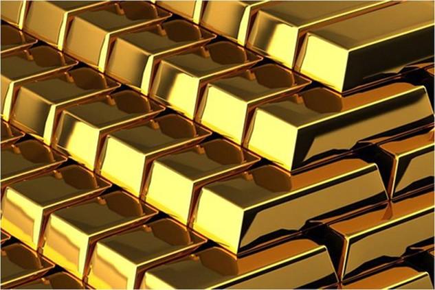 Giá vàng giảm gần 20 USD phiên đầu tuần. Ảnh: Barron.