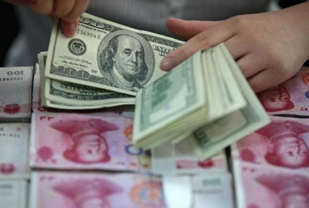Khối nợ lớn là một trong những nguyên nhân khiến NDT được dự báo yếu đi. Ảnh:Reuters