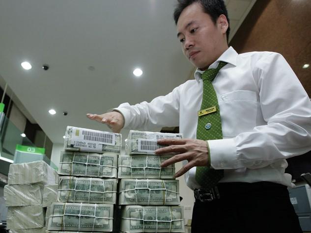 Chưa thể chấm dứt tín dụng ngoại tệ