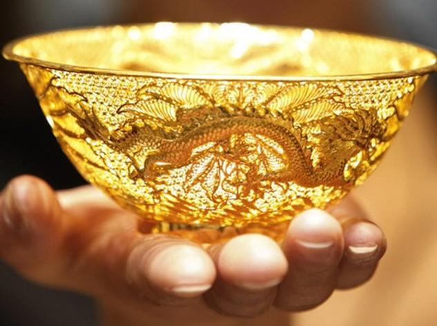 Mỗi ounce vàng có giá 1.267 USD sau khi từng lên mức cao nhất trong tuần. Ảnh:AFP.