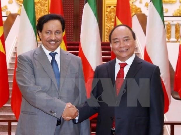 Thủ tướng Nguyễn Xuân Phúc và Thủ tướng Kuwait Sheikh Jaber Mubarak Al-Hamad Al-Sabad. (Ảnh: Thống Nhất/TTXVN)