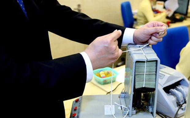 Tăng hoặc giảm tỷ lệ dự trữ bắt buộc đều dễ phát đi tín hiệu nhạy cảm về nới lỏng hoặc thắt chặt tiền tệ - Ảnh: Quang Phúc.