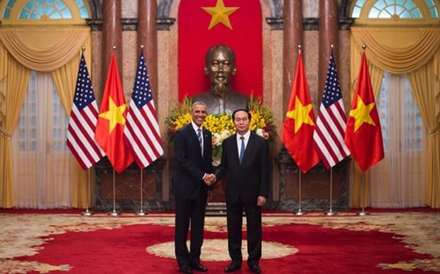 Chủ tịch nước Trần Đại Quang và Tổng thống Barack Obama - Ảnh: Reuters.