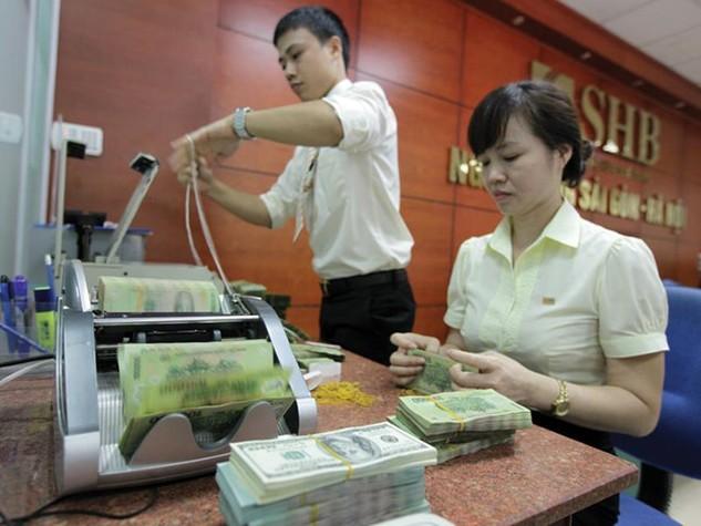 Hai yếu tố tác động lớn nhất đến tỷ giá trong nước là Trung Quốc phá giá nhân dân tệ và Fed tăng lãi suất USD.