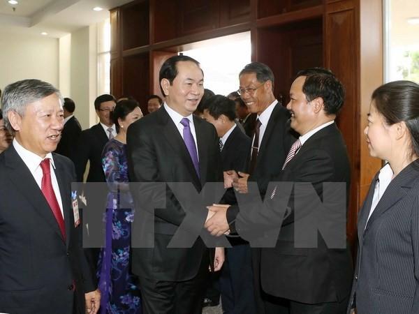 Chủ tịch nước Trần Đại Quang đến thăm, nói chuyện với cán bộ, nhân viên Đại sứ quán Việt Nam và đại diện cộng đồng Việt kiều đang học tập, làm ăn, sinh sống tại Lào. (Ảnh: Nhan Sán/TTXVN)