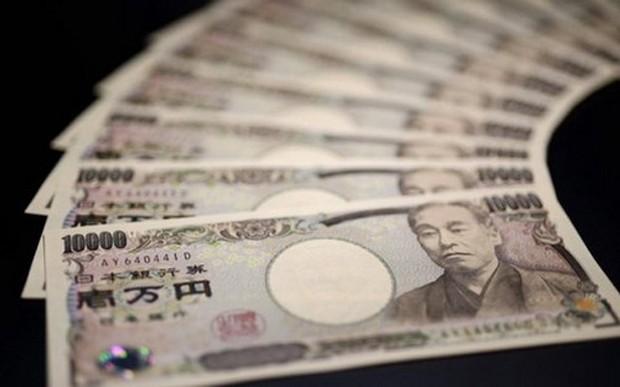 Một chuyên gia về thị trường tiền tệ tại ngân hàng Commerzbank, Frankfurt nhận định khả năng Ngân hàng Trung ương Nhật (BOJ) can thiệp hạ giá đồng Yên là không cao - Ảnh: WSJ.