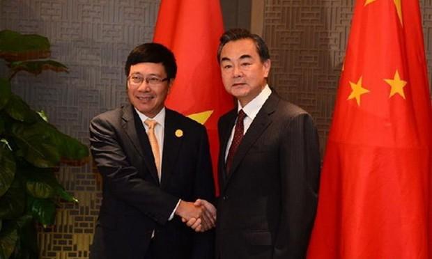 Phó thủ tướng, Bộ trưởng Ngoại giao Phạm Bình Minh (trái) và ông Vương Nghị, Bộ trưởng Ngoại giao Trung Quốc. Ảnh: fmprc.gov.cn.