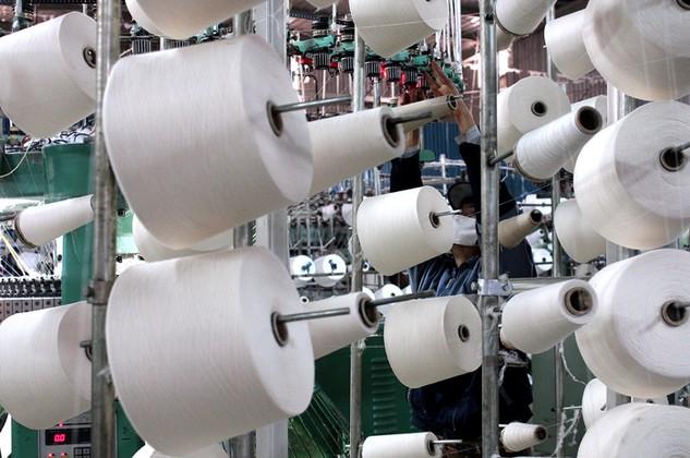 Doanh nghiệp Đài Loan xây dựng nhà máy dệt, sợi, nhuộm… tại Việt Nam để đón TPP. Ảnh: Lê Tiên