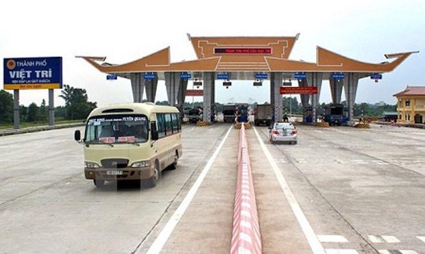 Trạm thu phí trên cầu Hạc Trì (Ảnh: TTXVN)