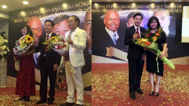Ông Nguyễn Thế Anh (áo vest đen) và ông Nguyễn Văn Thông (áo vest trắng) trong một hoạt động do công ty tổ chức để thu hút khách hàng - Ảnh: website của công ty Phúc Gia Bảo