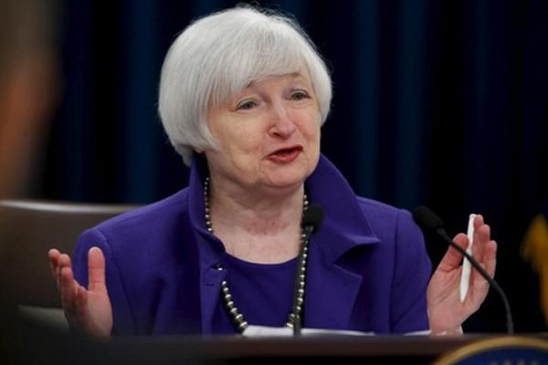 Chủ tịch Fed - bà Janet Yellen phát biểu tăng lãi suất năm ngoái. Ảnh: Reuters