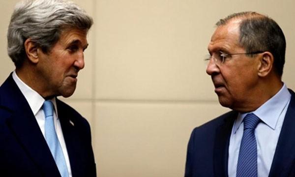 Ngoại trưởng Mỹ John Kerry (trái) và người đồng cấp Nga Sergei Lavrov. Ảnh:Reuters.