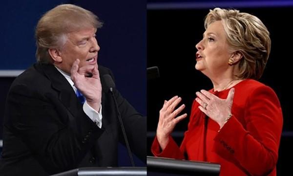 Ông Trump và bà Clinton trong lần tranh luận trực tiếp đầu tiên. Ảnh: Telegraph.