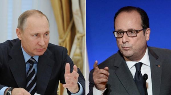 Tổng thống Nga Vladimir Putin và người đồng cấp Pháp Francois Hollande. Ảnh:RT